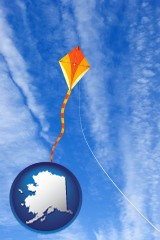 alaska map icon and flying a kite