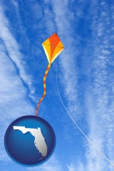 florida map icon and flying a kite