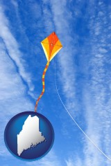 maine map icon and flying a kite
