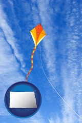 north-dakota map icon and flying a kite