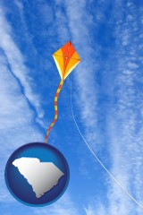 south-carolina map icon and flying a kite