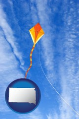 south-dakota map icon and flying a kite