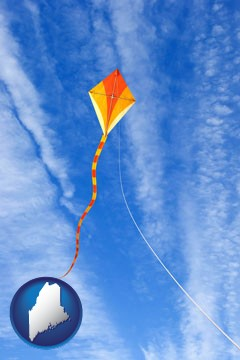 flying a kite - with Maine icon
